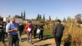 Facilitators lead funders through a community garden, part of a proposed public space for food system entrepreneurship, community education, and economic development. Image source: Ryan Van Lenning.