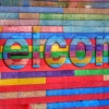 Colorful welcome on brick wall